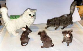 A Royal Doulton cat, a Beswick cat and three Beswick mice