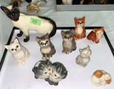 A large beswick siamese cat and a selection of Beswick kittens (8) and a small Royal Doulton group