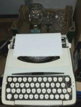 A Zephyr vintage portable typewriter, a cut glass globular vase, a cocktail style vase, a vintage