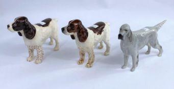 Three Beswick dog figures, English setter Bayldone Baronet, grey gloss 973, two Cocker Spaniels 967