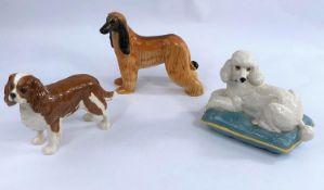 Three Beswick dogs, Afgan Hound 2285, King Charles Spaniel 2107 and Poodle on Cushion 2985