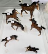 Six Beswick brown foals of various sizes