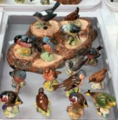 A Beswick bird stand and a large collection of Beswick birds (15)