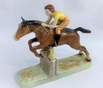 A Beswick group of girl on jumping horse 939, length 26cm (tail restored)