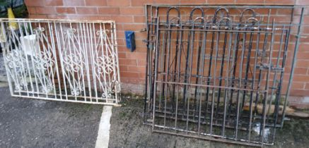 A pair of cast metal gates, another pair of cast metal gates, similar metal fencing