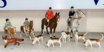 A Beswick hunting group: Huntsman 1501, Huntswoman 1730, Girl on Pony 1499, and Boy on pony 1500,