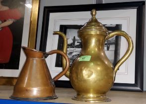 A Middle Eastern brass tea pot and a conical copper jug