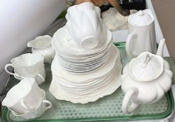 A Shelley six setting tea service comprising teapot, hot water jug, milk jug, cups and suacers, side