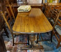 A reproduction oak dining suite with linen fold decoration comprising refectory table; 6 ladder back