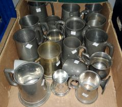 A collection of various pewter tankards etc