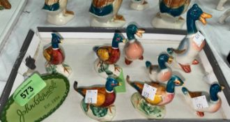 A group of four Beswick ducks and a group of four pheasants and a Beswick plaque