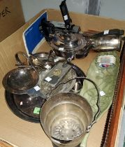 A circular silver plated tray and a selection of silver plated items, teapot, hotwater jug, a