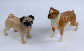 Two Beswick dogs, a Boxer 1202 and a Pug 1997