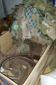 A WWII camouflage tin helmet; leather gaiters; etc.