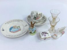 A small selection of Wedgewood Peter Rabbit items, a Beswick Peter Rabbit, two plates of