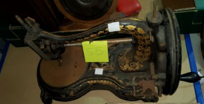 An early hand operated sewing machine by Jones