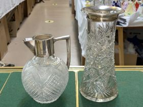 A hall marked silver collar and handled cut glass claret jug,and another
