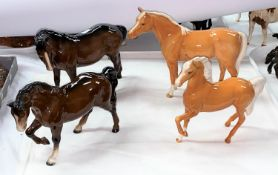 """Four Beswick horses: Arab """"Bahram"""" Palamino 1771, a Stocky Jogging mare 855, mare 976 and A prancing"""