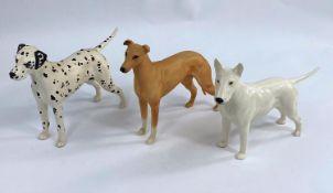 Three Beswick dog figures, Dalmation 961, Bull Terrier 970, and Greyhound matt glaze 972