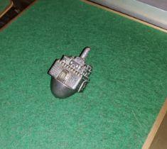 A white metal dreidel stamped 925