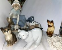 A small Beswick cat, a Lladro polar bear and a selection of Nao animals etc