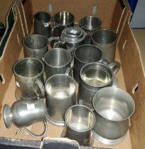 A collection of varios pewter tankards some with glass bases, a lidded example etc