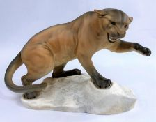 A large Beswick puma on a rock, matt glaze, number: 1072