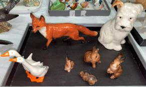 A selection of Beswick animals: a fox, a seated puppy 308, a goup of ducks and a selection of