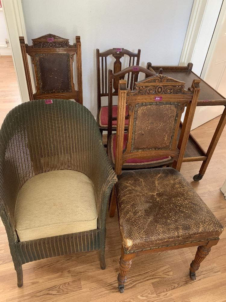 A Lloyd Loom chair, four chairs and an oak tea trolley