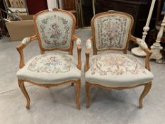 A pair of fauteuil elbow chairs upholstered in Aubusson style tapestry