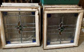 Ten stained glass window panels, each 18' x 16'