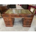 A pedestal desk with leather inlet top. Of recent manufacture. 54' wide