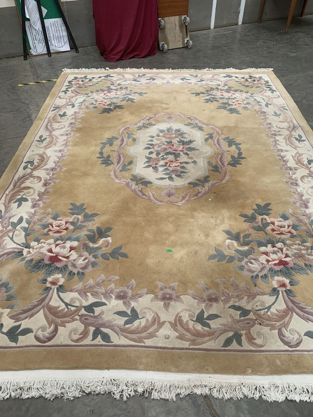 A Chinese carpet, 12' x 9'. Bears a label for Frith. 45' wide