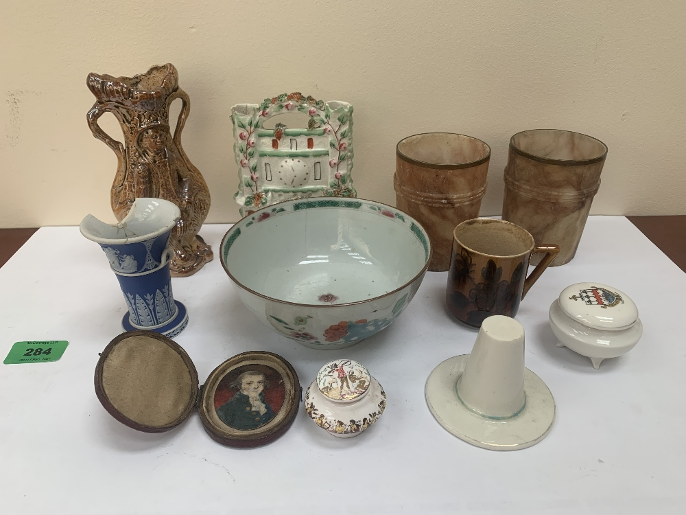 A pair of alabaster beakers, a Staffordshire spill holder, a Linthorpe pottery mug, a Chinese