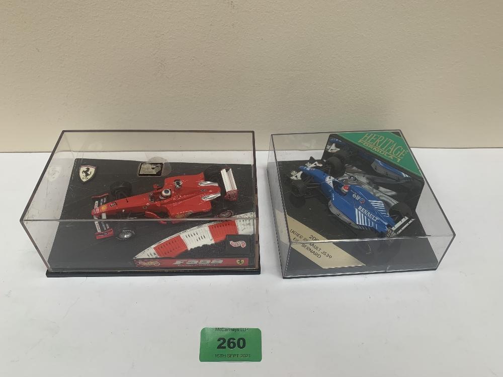A Hot Wheels 1-43 scale 1999 Ferrari F399 Michael Schumacher and a Heritage models 1-43 scale Ligier