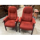 A pair of reclining upholstered armchairs