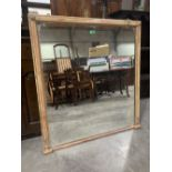 A 19th century Regency style overmantle mirror, the moulded parcel gilt frame with applied