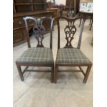 A pair of mahogany Chippendale style dining chairs with pierced splats