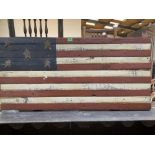 A stars and stripes painted wood panel. 23' x 48'
