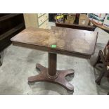 An early Victorian mahogany reading table on facetted column and quadripartite platform support.