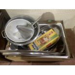 A box of stainless steel catering equipment