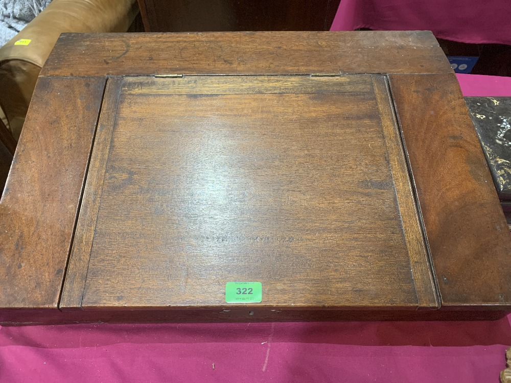 A 19th century mahogany writing box, the sloping fall enclosing a fitted interior. 23' wide