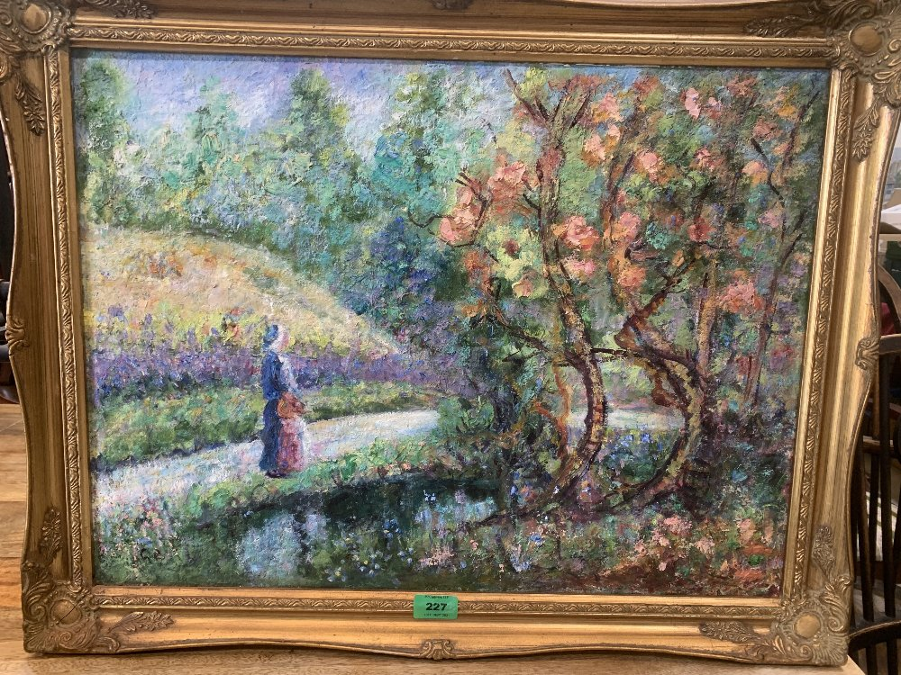 20TH CENTURY IMPRESSIONIST SCHOOL A lady in a park. Oil on canvas 18' x 24'
