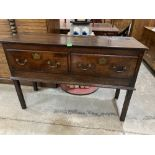 An 18th century oak dresser base with two drawers, raised on square legs. 50' wide