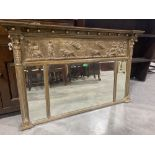 A Regency overmantle mirror with classical moulded frieze over three bevelled plates flanked by