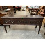 A George III decorated pine dresser base in original finish, the moulded top over three drawers,