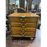 An early 20th century mahogany music chest of four fall-front drawers. 20' high