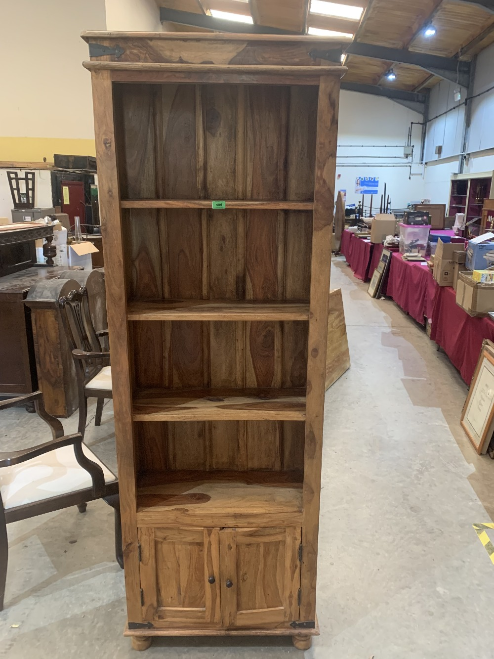 A hardwood open bookcase with three shelves over base cupboard. 79'h x 26'w