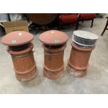 Three terracotta chimney pots, one cracked. 19' high