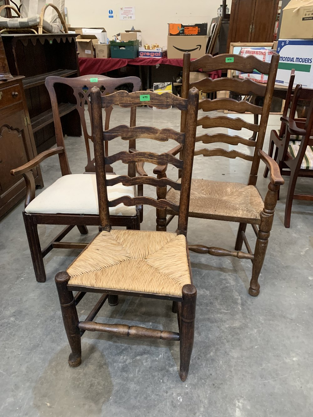 A Georgian elbow chair and two rush seat chairs